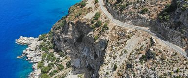 Aerial. Mountain asphalt road along the sea. View above.  stock image