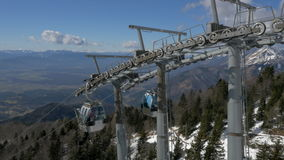 Aerial - Mountain cable cars ascending and descending stock video footage