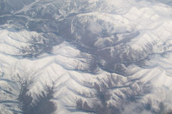 Aerial mountain range. View of a snowy mountain range from an aerial perspective Stock Images