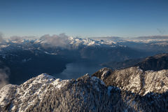 Aerial Mountain Range. Aerial mountain landscape view covered in snow. Picture taken near Howe Sound, South of Squamish, BC, Canada Stock Photo