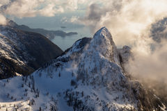 Aerial Mountain Range near Vancouver, BC. Beautiful landscape view of the snow covered mountains. Picture taken at the Vancouver North Shore, near Howe Sound, BC Stock Images