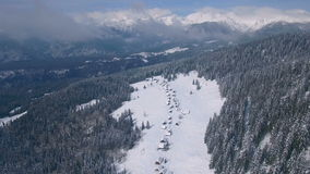 Aerial mountain settlement in winter (Zajamniki Mountain) stock footage