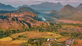 Aerial mountain valley sunrise view stock footage