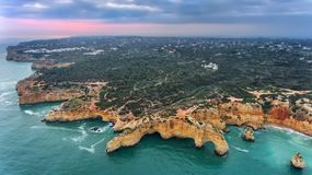 Aerial. Mountains and arches in the shape of a heart on the beach Marinha. Stock Image