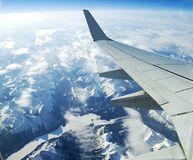 Aerial mountains and rivers. Aerial view from commercial aircraft over h Rockies Stock Image
