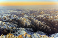 Aerial of the mountains in Tashkent, China and Kirgistan, covere with snow Stock Photo
