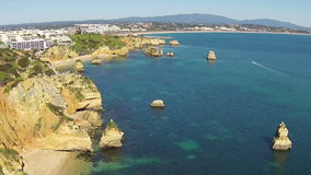 Aerial from natural rocks in Lagos Portugal stock video footage