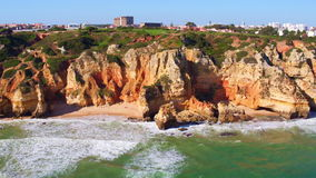 Aerial from natural rocks near Lagos in Portugal stock footage
