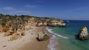 Aerial from natural rocks at Praia Tres Irmaos Alvor Portugal stock video