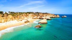 Aerial from natural rocks at Praia Tres Irmaos Alvor Portugal stock photos
