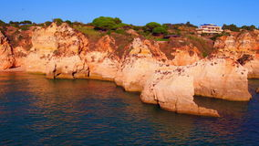 Aerial from natural rocks at Praia Tres Irmaos in Alvor Portugal stock video