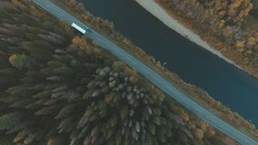 Aerial of nature. River parallel to the road. Tree crown. Aerial of nature. The camera moves in a circle. River parallel to the road. tree crown. Coniferous stock video