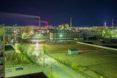 Aerial night cityscape of Baikonur. Factories and residential buildings royalty free stock photography