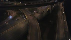 Aerial: Night Road Traffic on Freeway Interchange. 4K. stock video