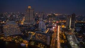 Aerial night scene of bangkok sky scraper beside chaopraya river Stock Images