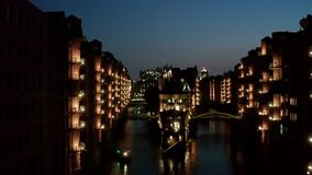 Aerial Night Speicherstadt in Hamburg Germany, is the largest warehouse area in the world, where buildings stand on a stock footage