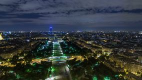 Aerial Night timelapse view of Paris City and Field of Mars shot on the top of Eiffel Tower. Observation deck. Evening illumination stock video footage