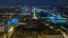 Aerial Night timelapse view of Paris City and Seine river shot on the top of Eiffel Tower. Observation deck. Evening illumination. Traffic on roads stock video footage