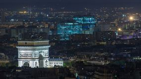 Aerial Night timelapse view of Paris City and Triumphal Arch shot on the top of Eiffel Tower. Observation deck. Evening illumination stock video footage