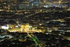 Night view of Paris. Aerial Night view of Arc de Triomphe and Paris City shot on the top of Eiffel Tower Stock Image