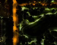 Aerial night view of a big city. Beautiful cityscape panorama at night. Aerial view of buildings and roads with car in the city at. Night time. Aerial bird`s stock images