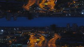 Aerial night view of a big city and beautiful lights, night life concept, mirror horizon effect. Media. Night cityscape royalty free stock photography