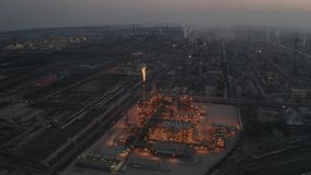 Night chemical factory. Aerial night view of chemical industry plant construction with large flame jet fire stock video