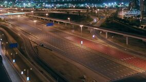 Aerial night view of empty highway and interchange without cars in Dubai