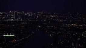 Aerial night view - illuminated streets and buildings of large city London stock footage