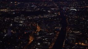 Aerial night view - illuminated streets and buildings of large city London. At night stock video