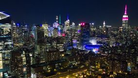 Aerial night view of Manhattan, New York City. Skyscrapers around. Timelapse dronelapse. NY from above stock footage