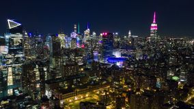 Aerial night view of Manhattan, New York City. Skyscrapers around. Timelapse dronelapse. NY from above stock video