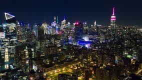 Aerial night view of Manhattan, New York City. Skyscrapers around. Timelapse dronelapse. NY from above stock video footage