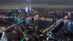 Aerial night view of Manhattan, New York City. Tall buildings. Timelapse dronelapse.