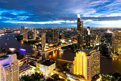 Aerial night view over Bangkok modern office building in bangkok business zone near the river with sunset sky in Bangkok, Royalty Free Stock Photo