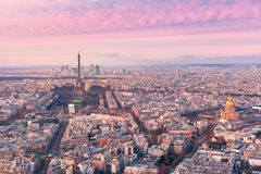 Aerial night view of Paris, France. Aerial panoramic view of Paris skyline with Eiffel Tower, Les Invalides and business district of Defense at pink sunset, as Royalty Free Stock Photo