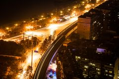 Aerial night view of a road junctions with cars lights in Wuhan. Aerial night view of a road junctions with cars lights trail in Wuhan central China Stock Image