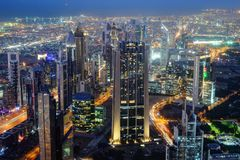 Aerial night view of skyscrapers of Dubai World Trade center Stock Images