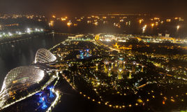Aerial night view of The Supertree Grove at Gardens near Marina Bay with the sea in the background Stock Photos