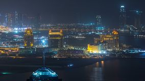 Aerial night view to Pearl-Qatar timelapse from top. It is an artificial island in Qatar. View of the Marina and residential buildings in Doha, Qatar, Middle stock footage