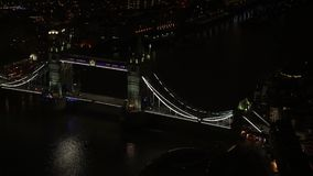 Aerial night view of Tower Bridge over river Thames in London.  stock video