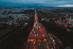 Aerial night view of the traffic road with cars passing through the point of toll highway, toll station. royalty free stock photography