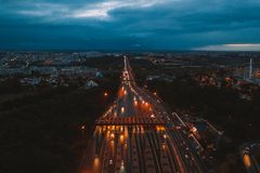 Aerial night view of the traffic road with cars passing through the point of toll highway, toll station. royalty free stock image