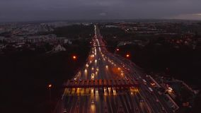 Aerial night view of the traffic road with cars passing through the point of toll highway stock video footage