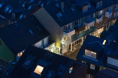 Aerial night view village Helgoland with lluminated main street Stock Image