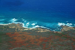 Aerial of Northwest coast of Molokai with waves crashing into sh Stock Photography