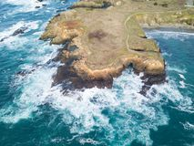 Aerial of Ocean and Mendocino Coastline in California. The cold waters of the Pacific Ocean wash against the beautiful coastline of Mendocino in northern Royalty Free Stock Image