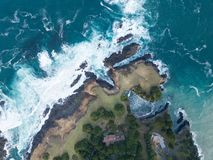 Aerial of Ocean and Mendocino Coastline in California. The cold waters of the Pacific Ocean wash against the beautiful coastline of Mendocino in northern royalty free stock images