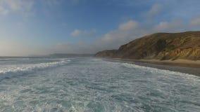 Aerial from ocean waves at the atlantic ocean stock video footage