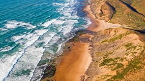 Aerial from ocean waves hitting the shore from the westcoast in. Portugal Stock Photo